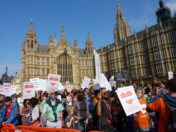 Marchers pass the Houses of Parliament