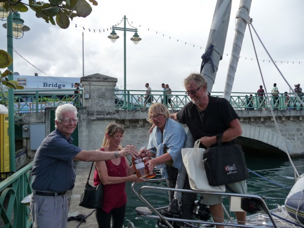 Peter Bruce of the Barbados Yacht Club welcoming Hakuna Matata II