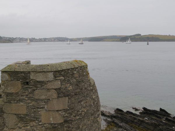 The yachts sail past Pendennis Head